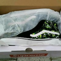 unpaired black and green Nike basketball shoe New York