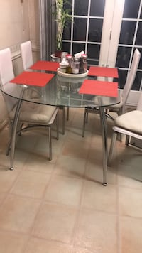 rectangular clear glass-top table with chairs