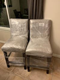 Two brown wooden framed gray padded chairs El Cajon, 92020