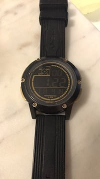 DKNY Men's black digital watch with black rubber strap. Good condition, hardly used, brand new battery Toronto, M5G