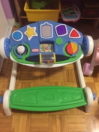 green and white Fisher-Price learning walker 536 km