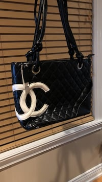 women's black and white leather quilted Chanel tote bag