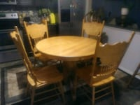 oval brown wooden dining table with chairs set Colorado Springs, 80909