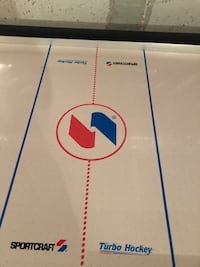 Air hockey table. Good condition. Come with pucks and 4 sliders