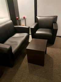 two black leather padded armchairs Montreal, H3H 2P3