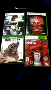 four Xbox 360 game cases