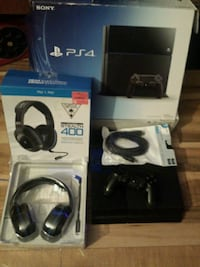 black Sony PS4 console with controller and game ca Abbotsford, V2T 4B4