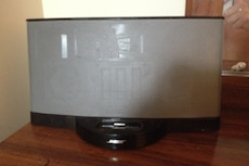 Gray and black Bose docking speaker