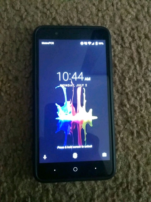 black ZTE with charger boost mobile