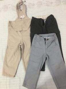 children's beige dungaree and two black and gray jeans
