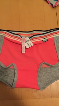 red and gray Nike shorts Carpentersville, 60110
