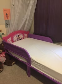 Girls Minnie Mouse bed. Rarely used- Like new. Mattress NOT INCLUDED.