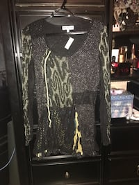 Women's brand new sweater with tags size small