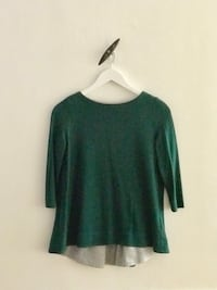 A soft and comfortable green blouse from COS. 6241 km