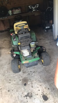 green and yellow ride-on lawnmower 42 km