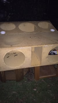 white and brown wooden subwoofer enclosure