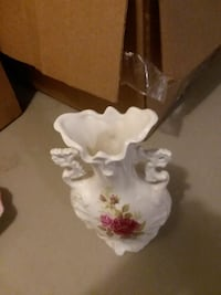 white and pink floral ceramic vase