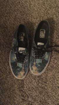 pair of black-and-white Vans sneakers Palm Bay, 32909