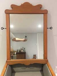 Brown wooden framed wall mirror 793 km
