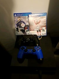 Sony PS4 console with two controllers and game case Montréal, H2E 2N6