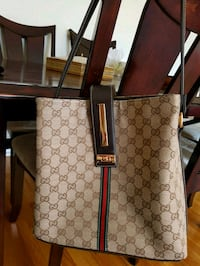 brown and gray monogrammed Gucci leather tote bag Mount Royal, H4P 1B3