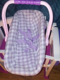 Baby doll carrier, baby doll and bell