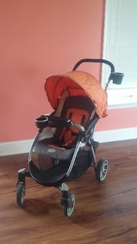 baby's red and black stroller ASHBURN