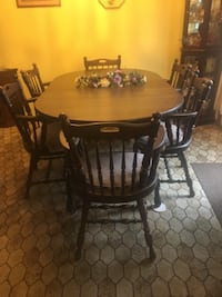 Dining room table and six captain chairs.   WASHINGTON