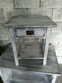 white wooden single-drawer side table