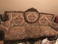 brown, red, and gray floral fabric 3-seat sofa