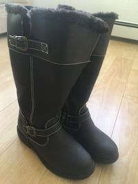 Pair of black leather boots Halifax, B3M 3N1