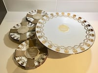 Gold skull cake stand and 12 matching dessert plates  Surrey