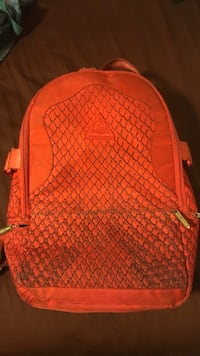 red and black leather backpack Coconut Creek, 33063