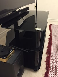 Black Tv stand good condition no scratches on  it just I bought a new one the price is negative London, N6B 0B1