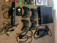 black Xbox 360 with two controllers 40 km