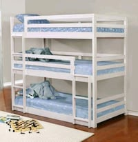 Triple white wood bunk beds without mattress