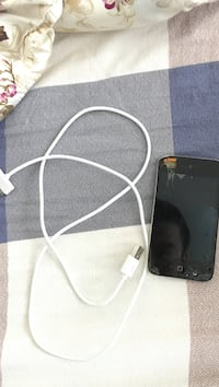 Black ipod touch with white charging cabl