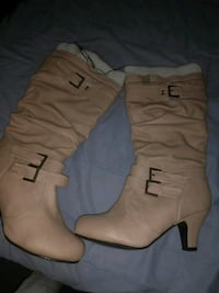 pair of brown leather heeled boots Calgary, T1Y 3Z8