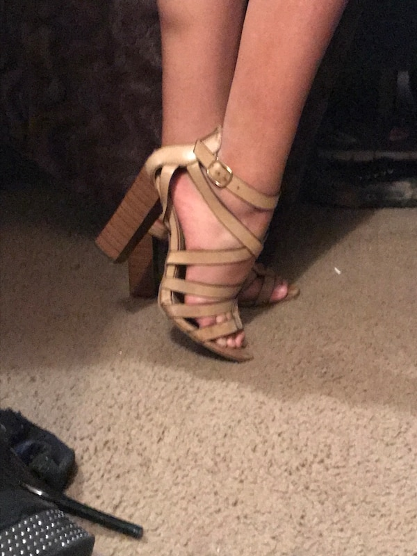 pair of beige leather strappy open-toe chunky-heeled sandals