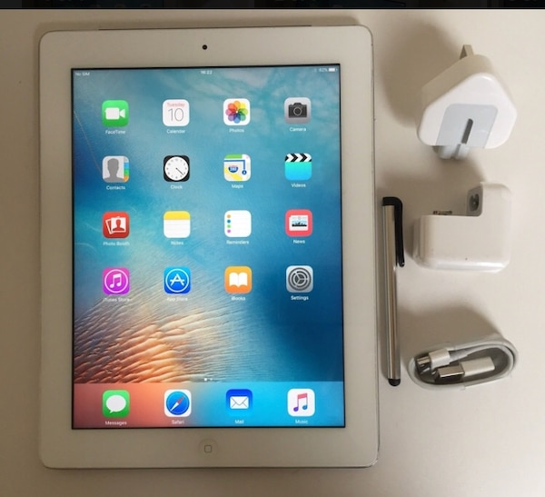 white iPad with charger adapter