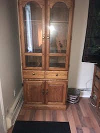 Brown wooden china cabinet with a light inside Edmonton, T5H 1L9