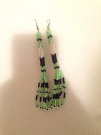 pair of white-and-black beaded silver-colored hook earrings