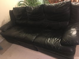 Black leather couch w two reclining seats