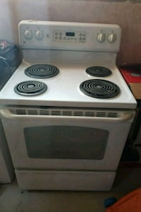 white and black 4-burner electric coil range oven
