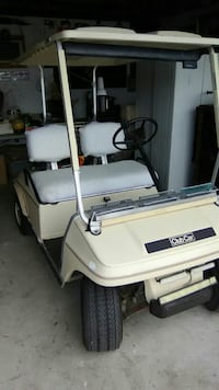 beige and gray Club Master golf cart