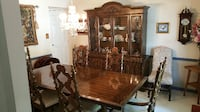 Solid wood china hutch, dining room table and 6 chairs. CENTREVILLE