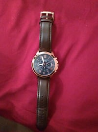 round silver chronograph watch with black leather  Detroit, 48238