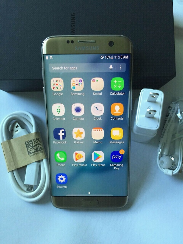 Samsung Galaxy S7 edge with headphones and charger