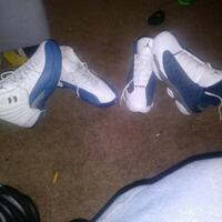 pair of white-and-blue Air Jordan shoes