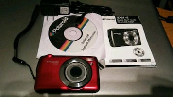 red and gray Polaroid point-and-shoot camera